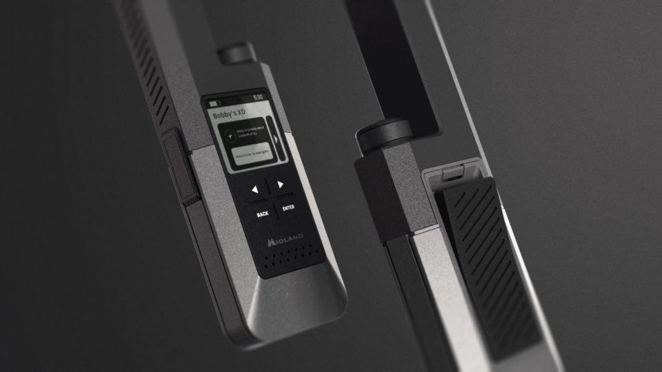 Two-way radios on a dark grey background