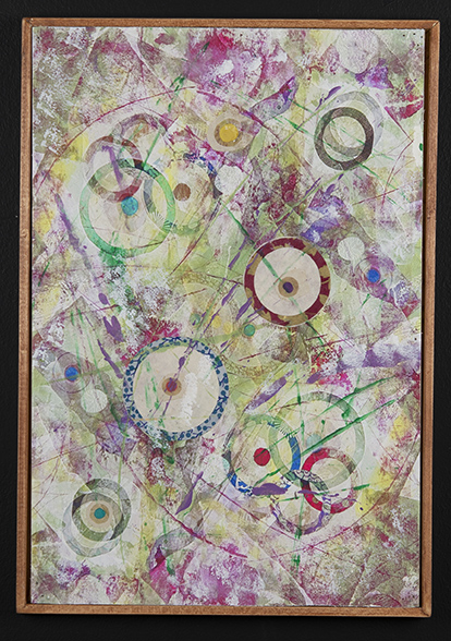 A dynamic collage design. Well blended colors with varying sizes of collaged circle cut outs.