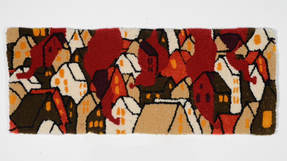 Tufted Rug depicting houses on fire