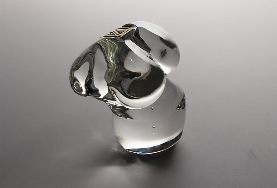 Nude female glass torso in contropasto with gold stamp where the neck would be