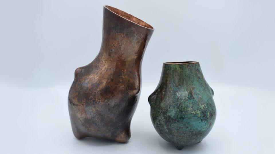 Copper vessels, one teal, one brown/black
