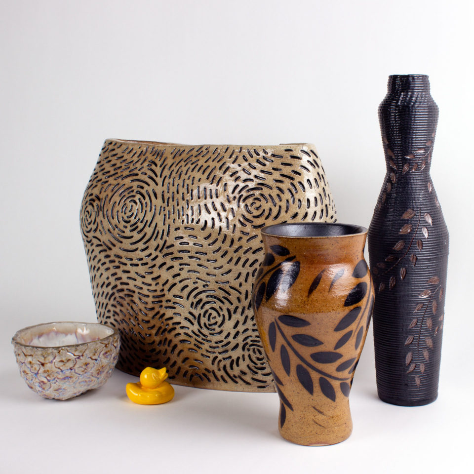Five ceramic pieces displayed together of various sizes