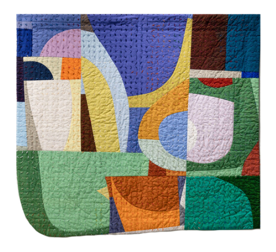 Multi-color patch fabric in the style of a quilt