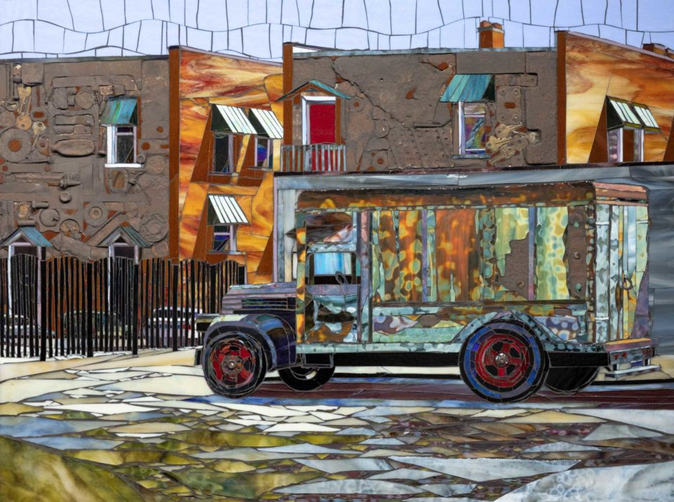 Mosaic of a truck and buildings made from glass and found objects