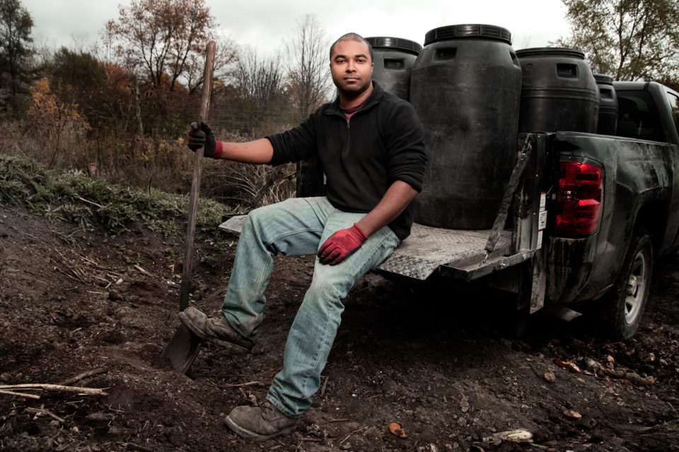 Environmental portrait, outdoors, shovel and truck