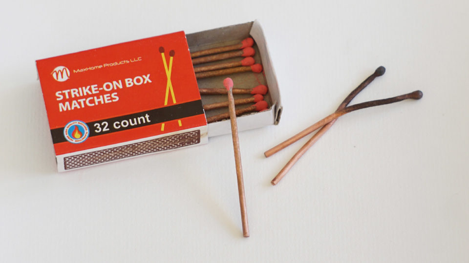 Sculpture of a matchbox with matches made from cooper