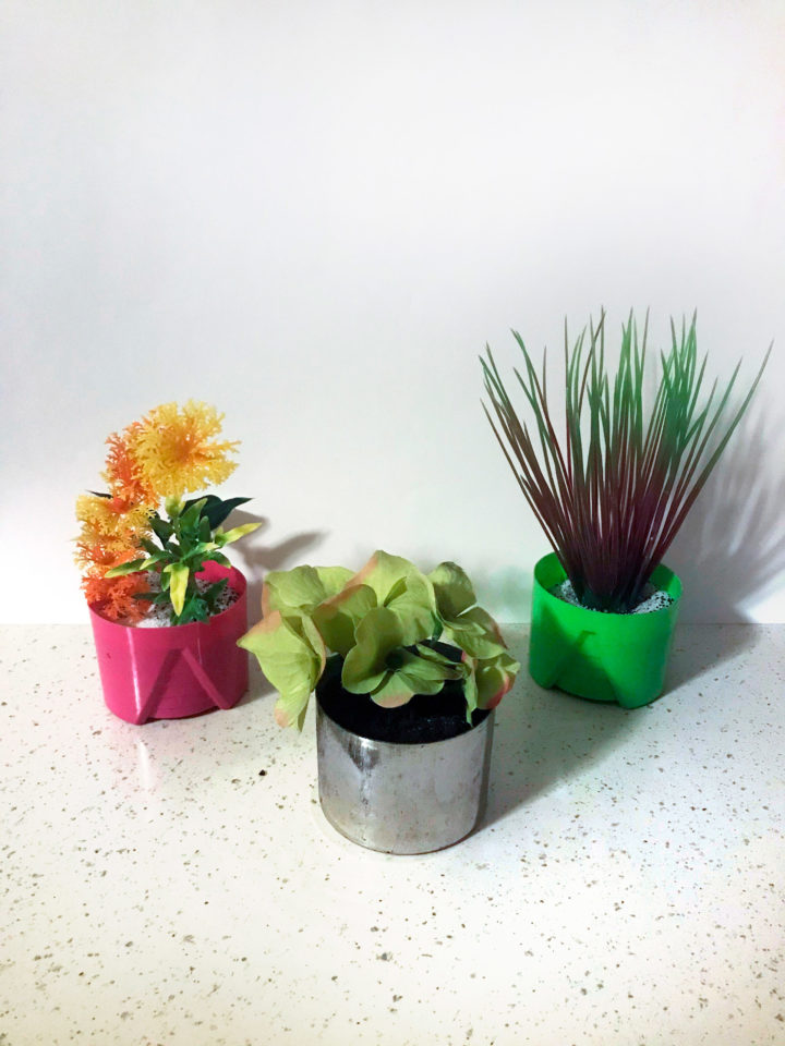 Spray can lids used as pot planters (fake plants)