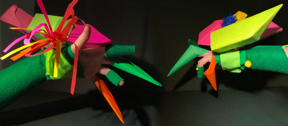 Hand wearing green felt and construction paper