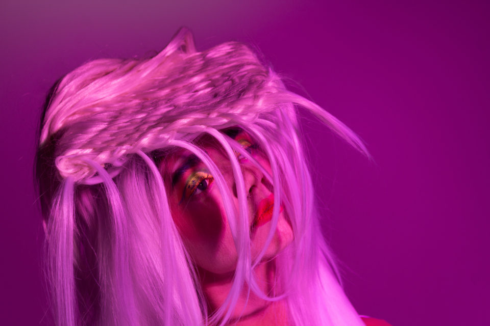 Pink and purple lighting showing female model